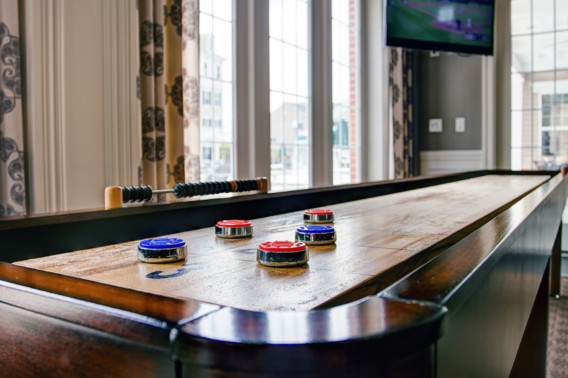 Shuffle board table at Creekstone Village apartments in Pasadena, MD