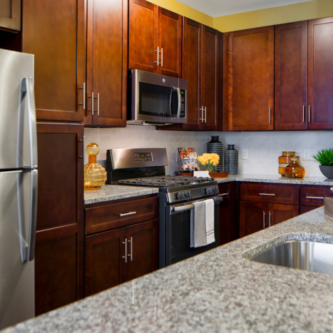 Espresso cabinet kitchen at Creekstone Village apartments in Pasadena, MD