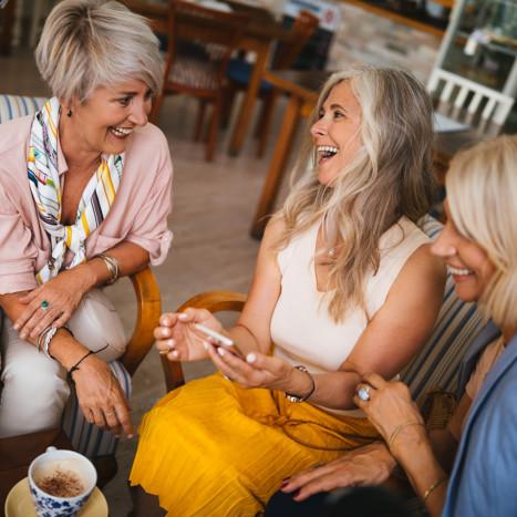 Women smiling and having coffee | Creekstone Village