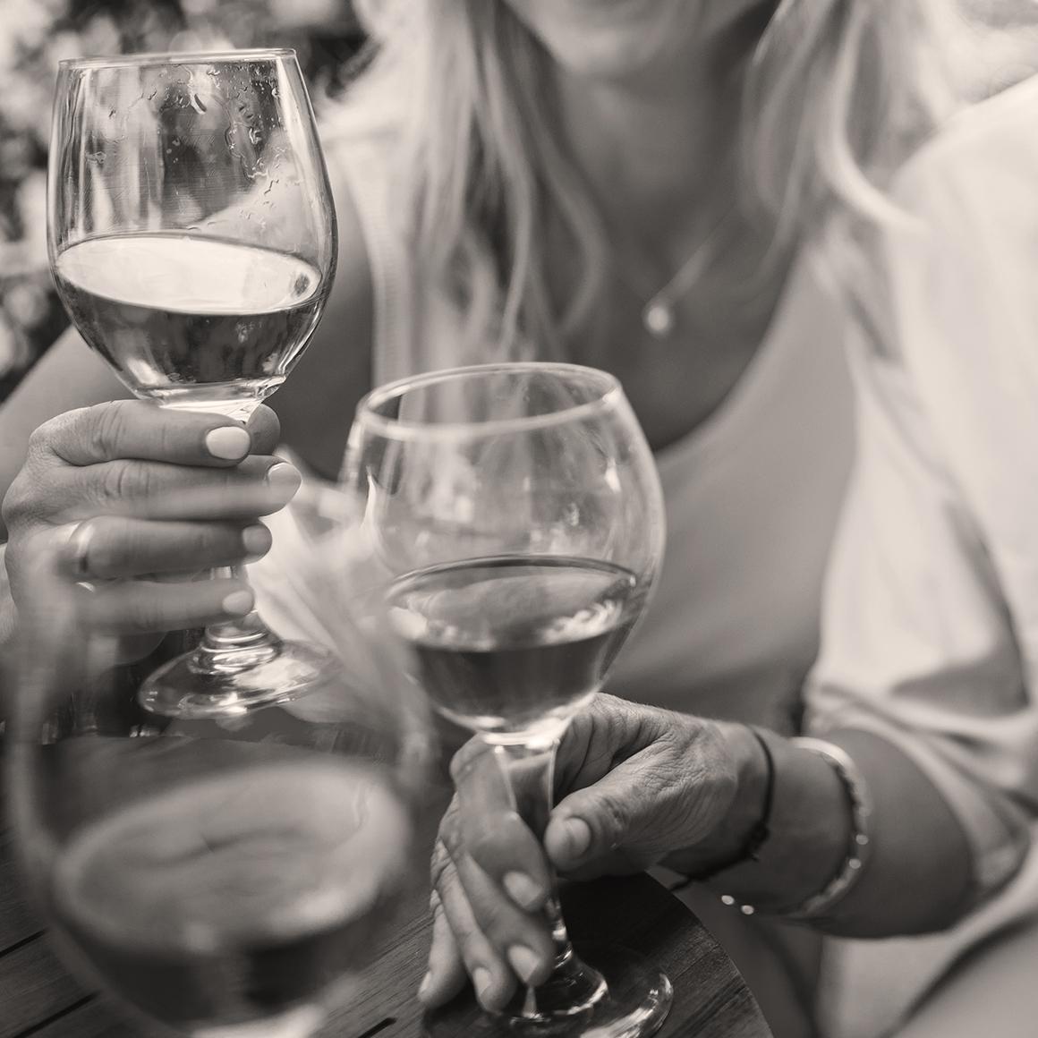 Women holding wine glasses | Creekstone Village