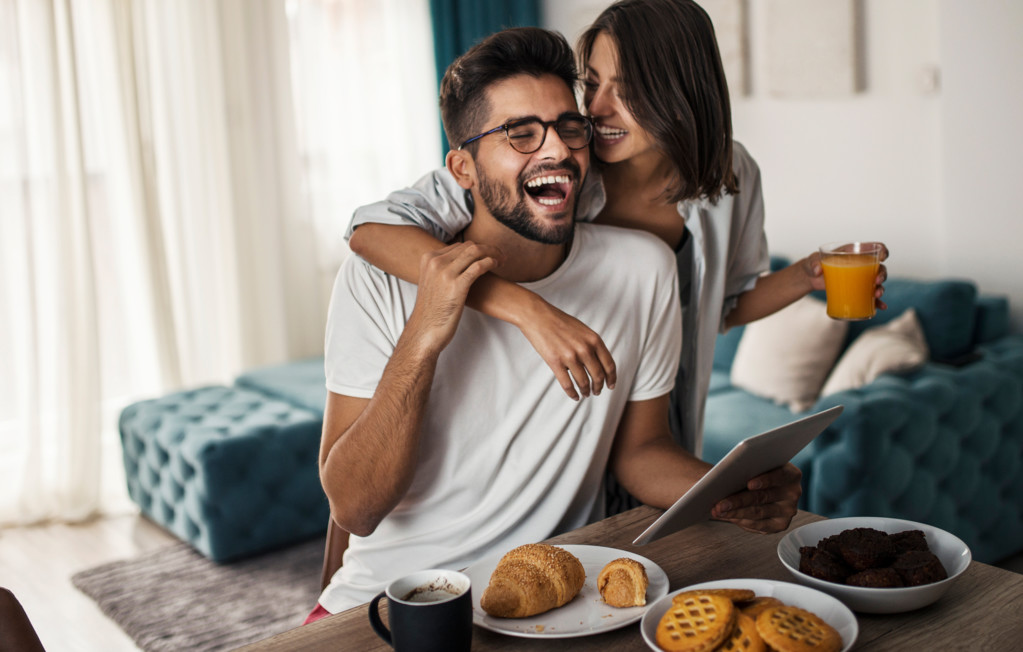 Couple smiling having breakfast | Creekstone Village