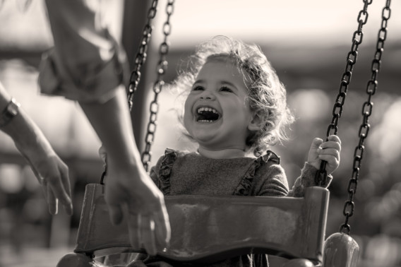 Photo of happy girl on swing | Creekstone Village